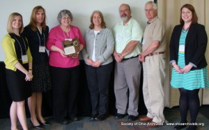 SOA President Judith Wiener presenting Merit Award to OHRAB member Janet Carleton, accepting on behalf of the Ohio Historical Records Advisory Board, May 21, 2014. Others in photo are past or present OHRAB members (Laurie Gemmill Arp, Carleton, Dawne Dewey, Ron Davidson, George Bain). At right is Jillian Carney, OHS staff member who facilitates the board's work and Council liaison to the Awards Committee.