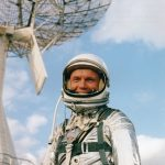 John Glenn posing in front of the radar dish at Cape Canaveral, Florida in 1962