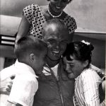 Marine Major New Speed King, July 17, 1957. Major Glenn embraces children while wife Ann looks on